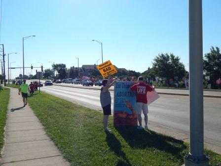 At 9 am the protest against Planned parenthood begins at the intersection of E. New York St. and Oakhurst Dr., Aurora, IL
