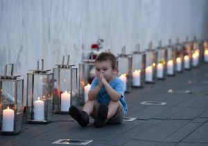 Blake Catanese sits near 40 candles at the Flight 93 Memorial Wall
